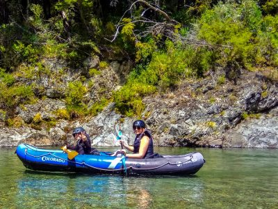 Couple of Friends Enjoying Kayaking in New Zealand