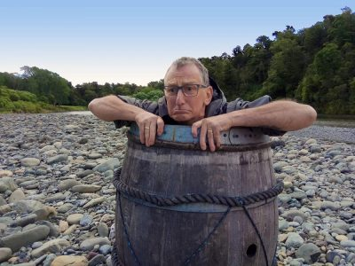 Funny Kayaker in a Barrel at the Pelorus River, New Zealand