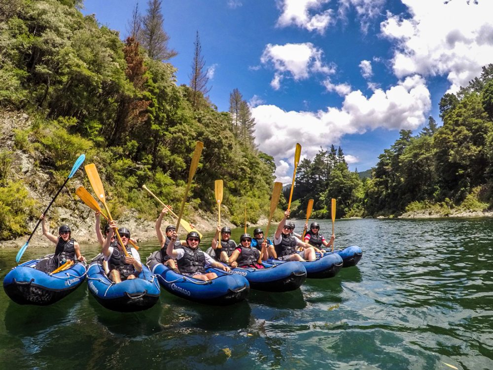 Big Group Kayaking the Pelorus River in New Zealand