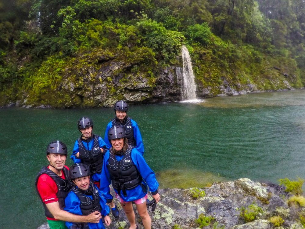 Family Kayaking the Pelorus River in New Zealand