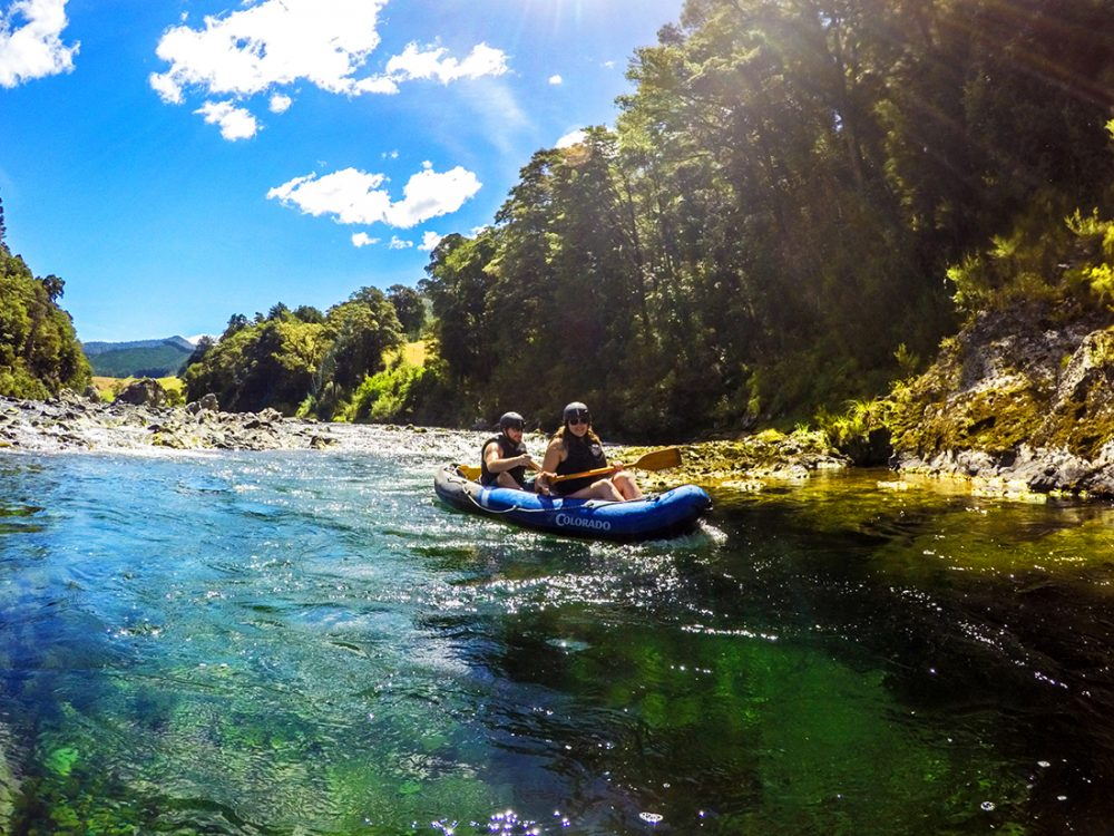 Couple Kayaking River in New Zealand