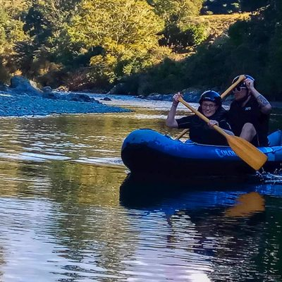 Couple kayaking New Zealand River