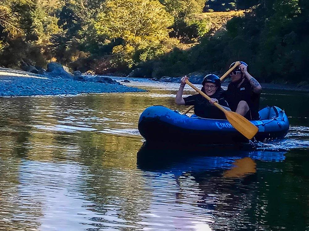 Couple kayaking New Zealand River