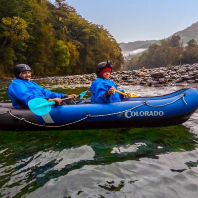 Dad and Son Kayaking the Pelorus River
