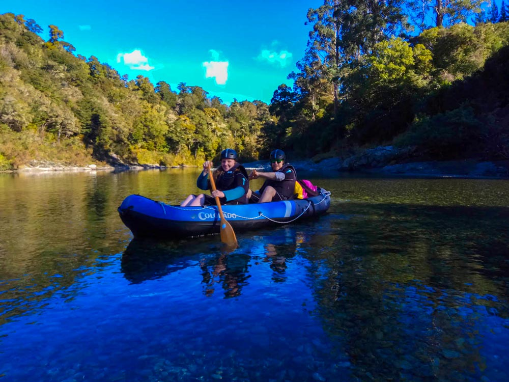 Friends Kayaking New Zealand River