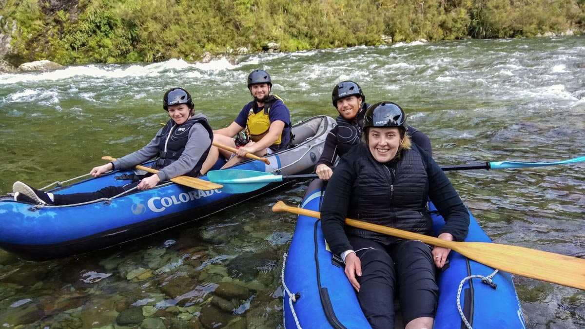 Group of Friends Kayaking in New Zealand