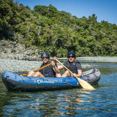 Friends Kayaking on the Pelorus River, New Zealand