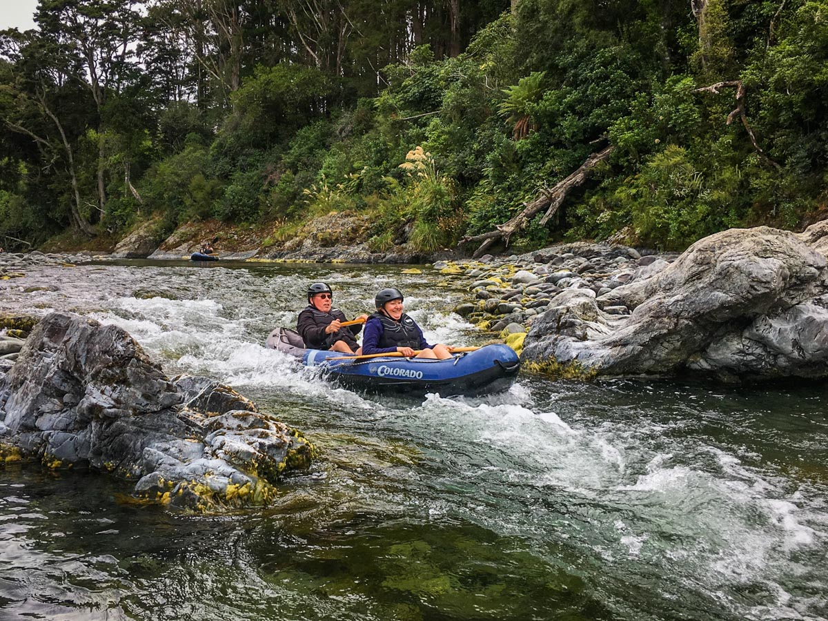 Couple Kayaking Rapids in New Zealand