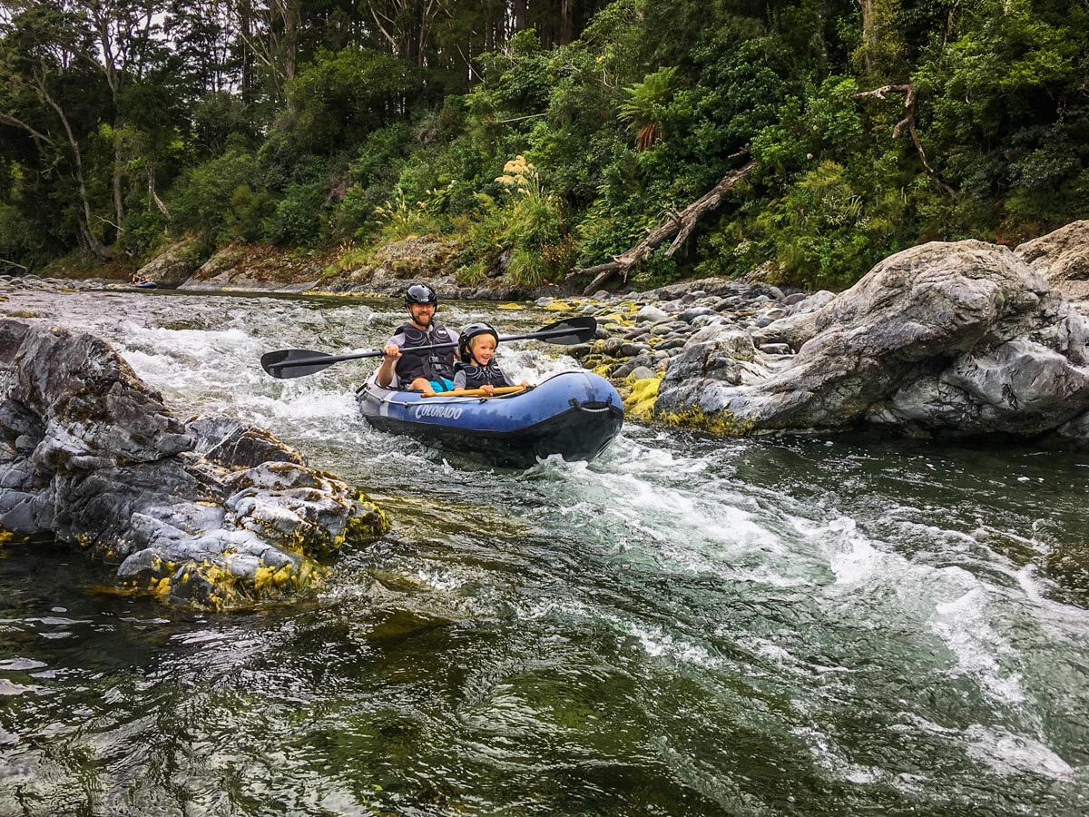 Dad and Son Kayaking Rapids, NZ