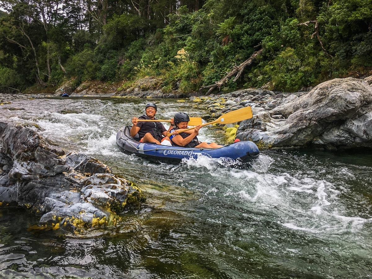 Friends Kayaking Rapids in New Zealand
