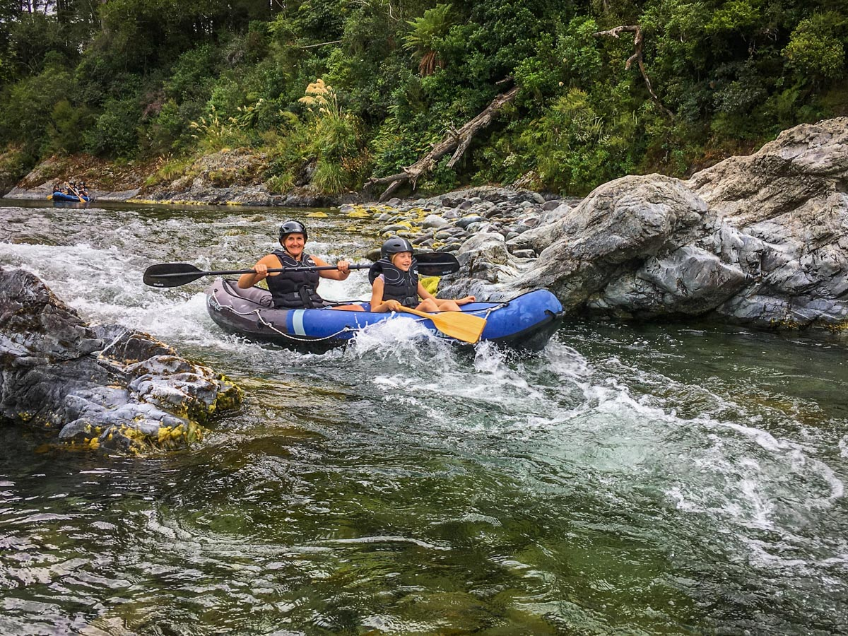 Mum and Daughter Kayaking the Rapids