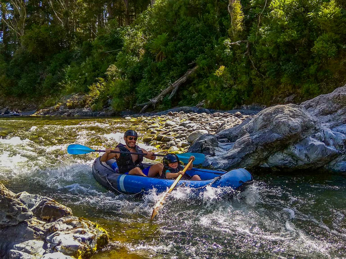 Dad kayaking with his kid at the Pelorus River