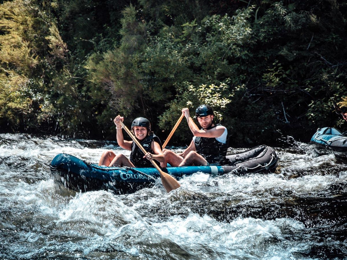 Couple Kayaking the Pelorus River Rapids