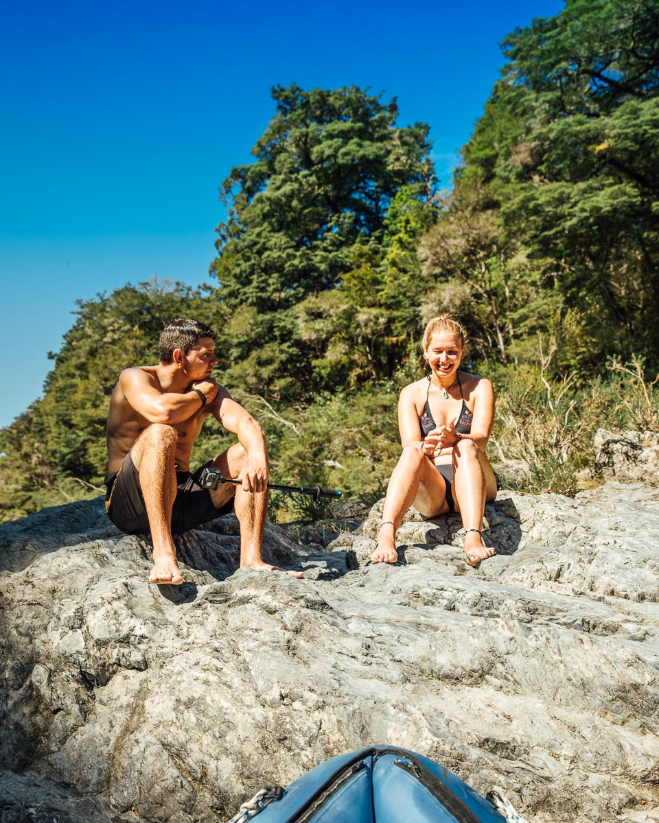Couple enjoying the sun at the Pelorus River