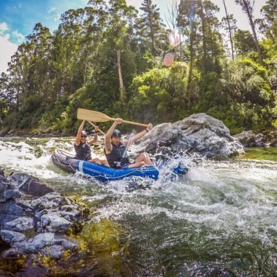Couple Kayaking Pelorus River Rapids