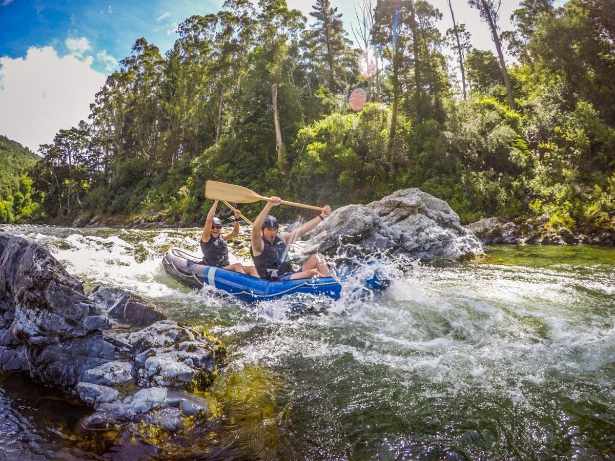 Couple Kayaking Pelorus River Rapids