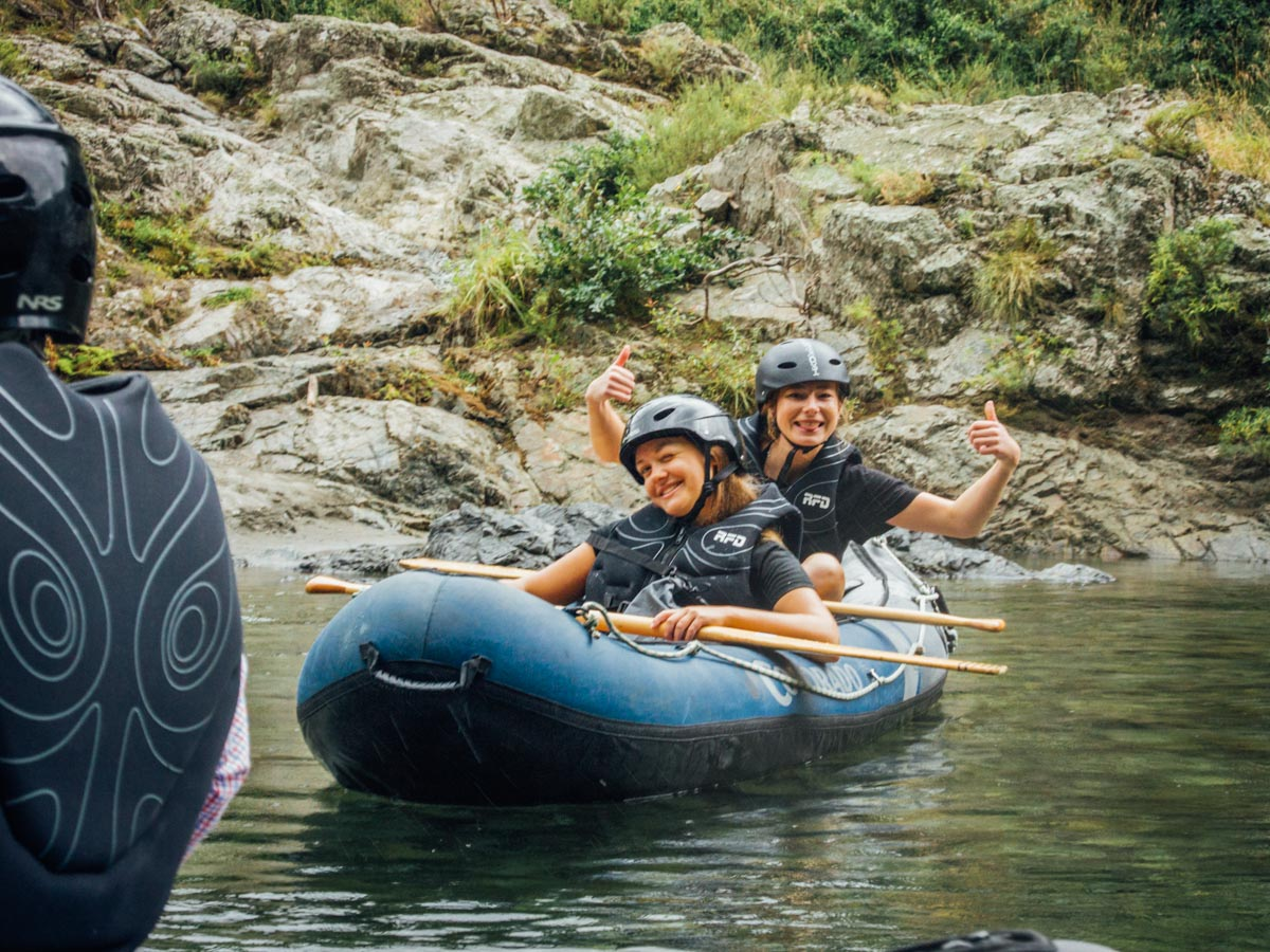 Friends having fun Kayaking in New Zealand