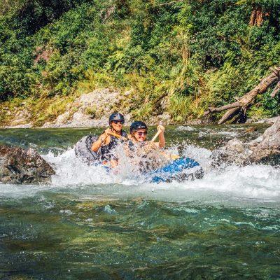 Friends Kayaking Rapids at the Pelorus River