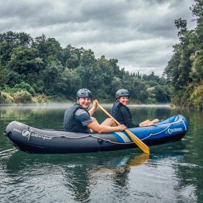Happy Couple Kayaking in New Zealand