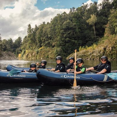 Family Group Kayaking in New Zealand