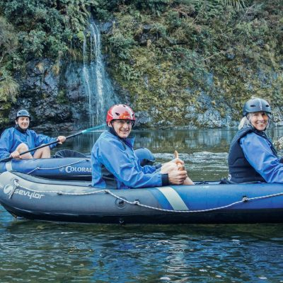 Friends kayaking close to Pelorus river's falls