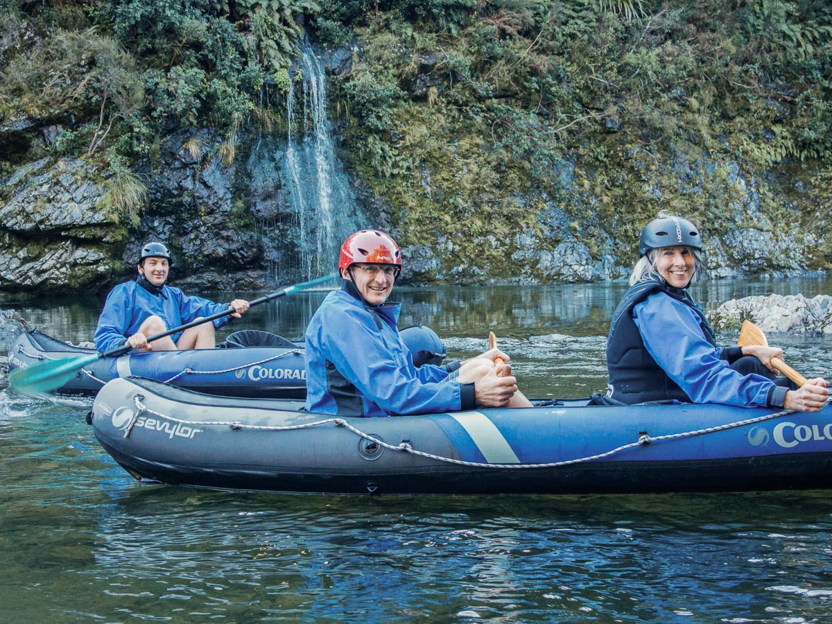 Friends kayaking close to Pelorus river's falls