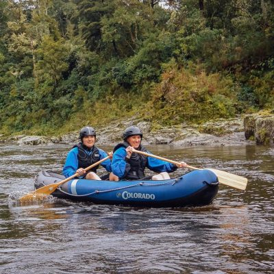 Friends kayaking the Pelorus river, Marlborough