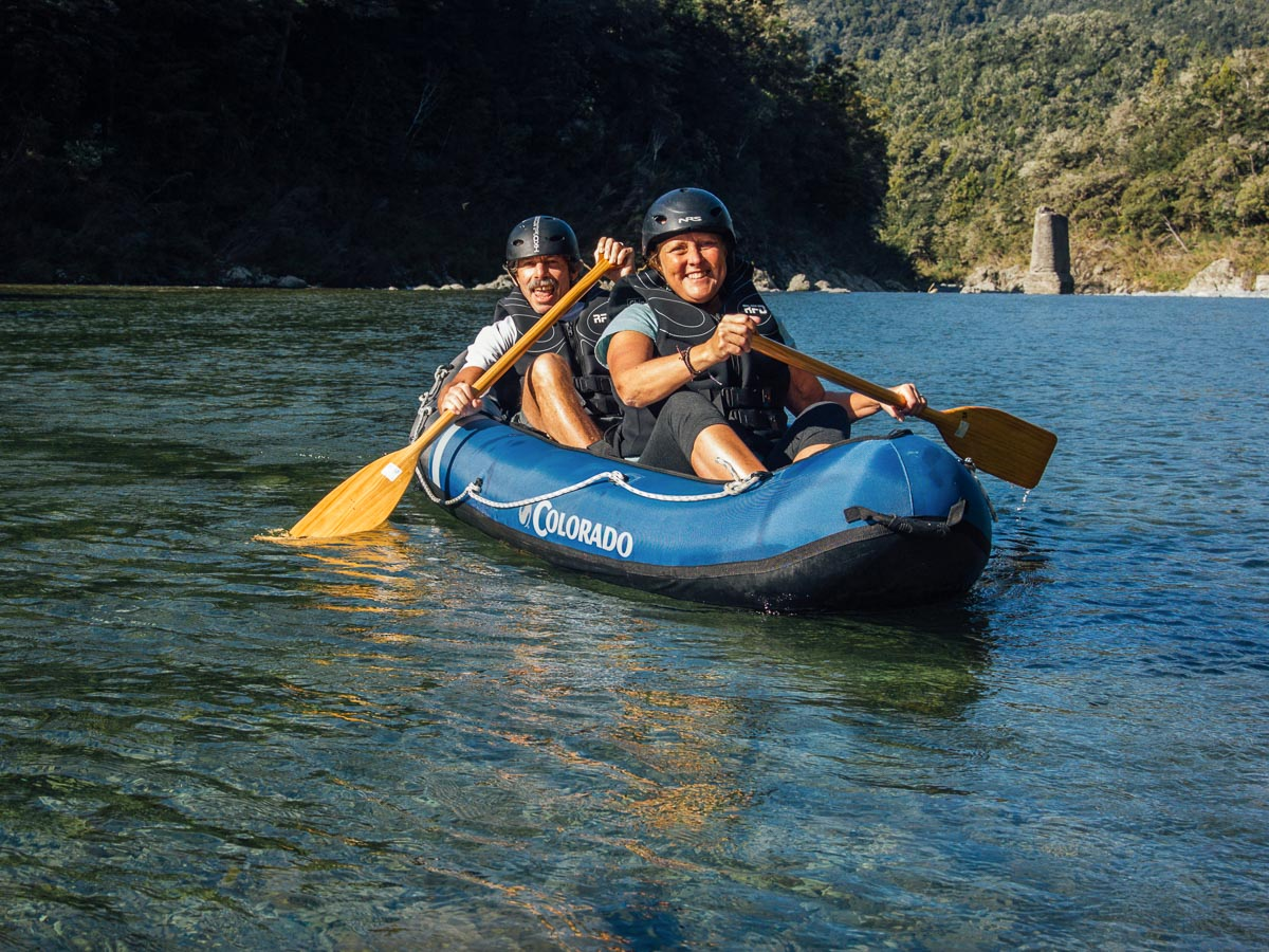 Happy couple kayaking the Pelorus river, NZ