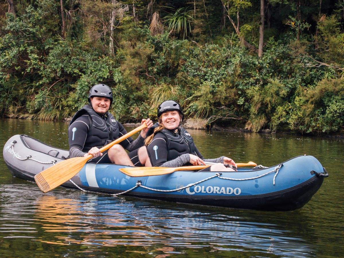 Happy couple kayaking the Pelorus river