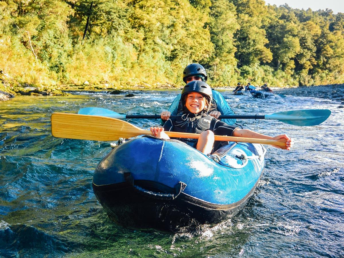 Happy family kayaking the Pelorus river