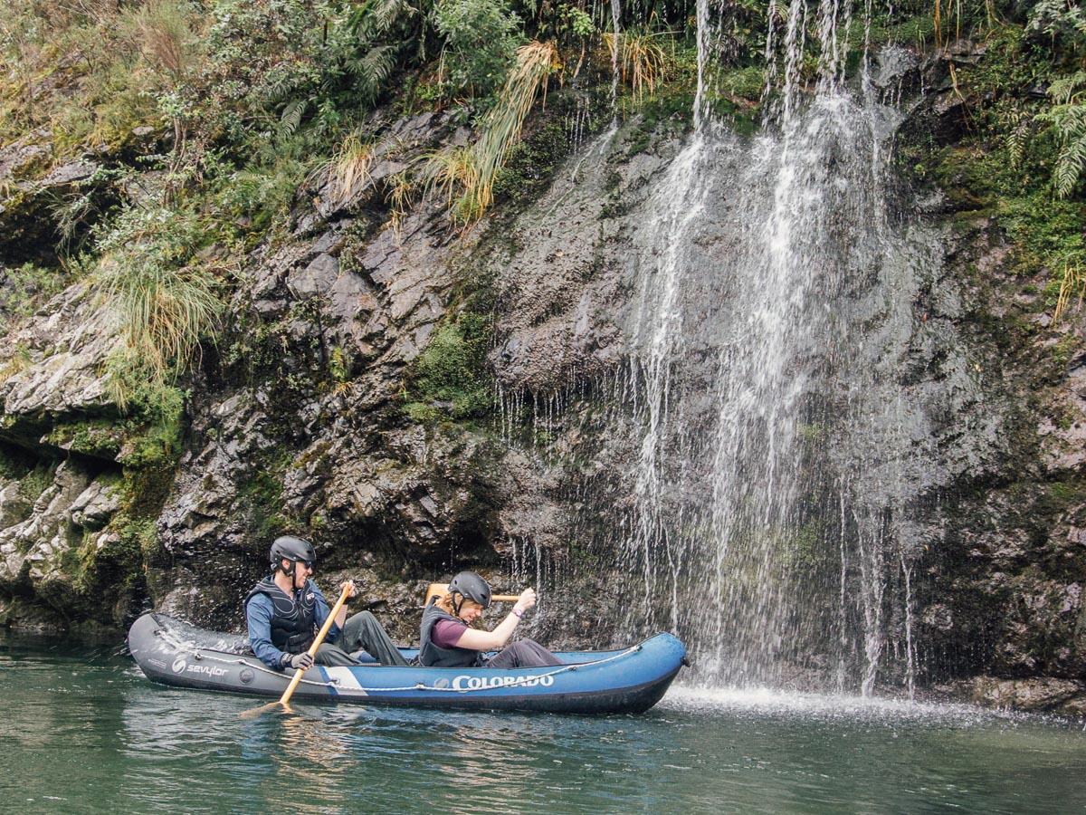 Kayaking behind falls at the Pelorus river