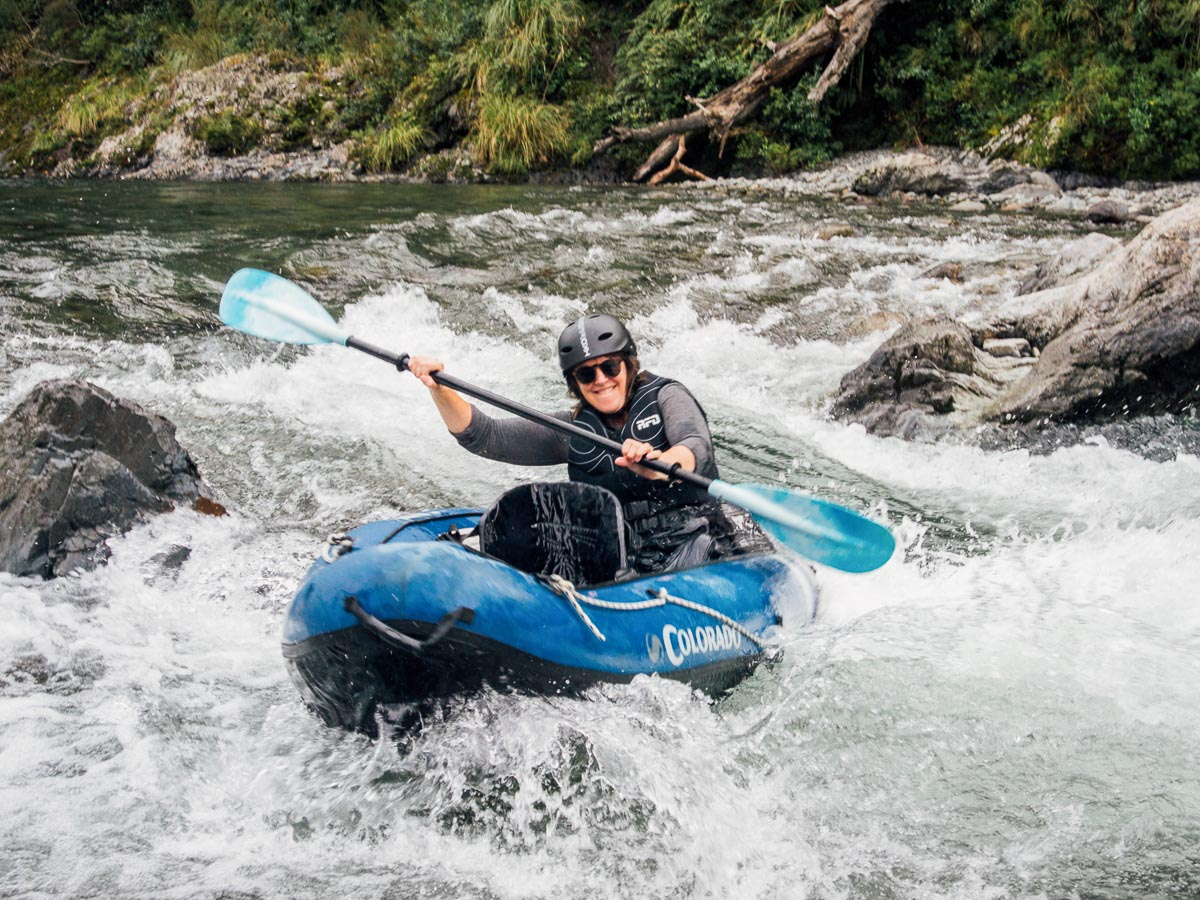 Lady kayaking rapids at the Pelorus river
