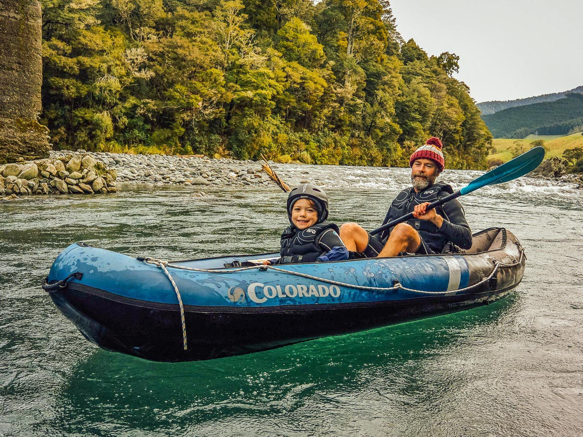 Dad and kid kayaking in New Zealand