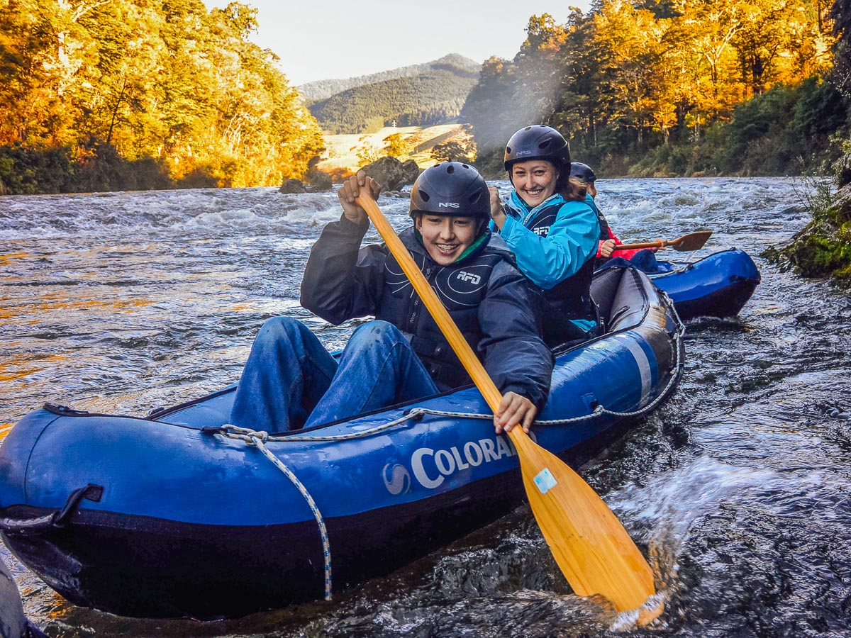 Happy family kayaking in New Zealand
