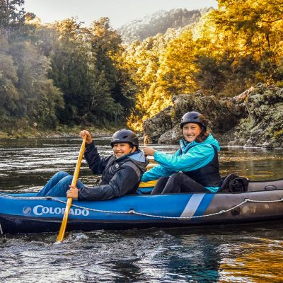 Happy mum and son kayaking in NZ