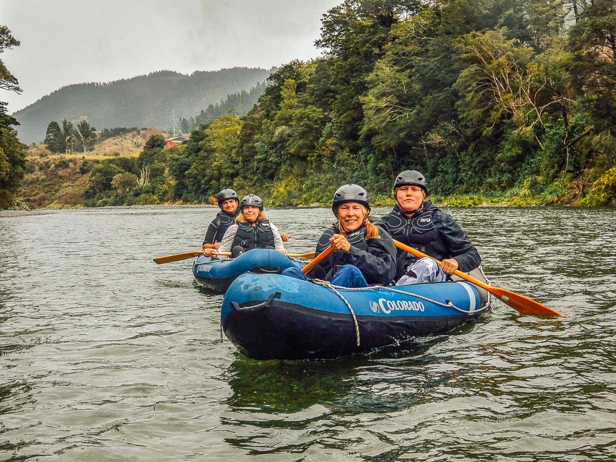 Friends kayaking the Pelorus river