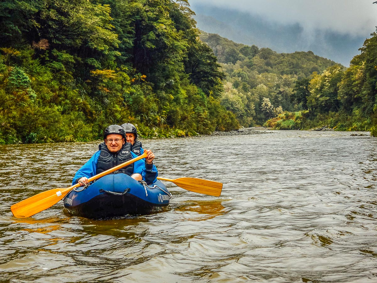 Couple kayaking at New Zealand river