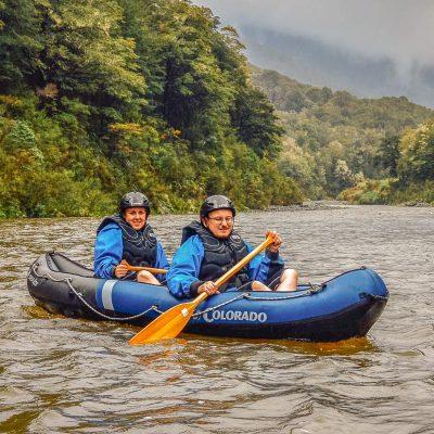 Couple kayaking NZ river