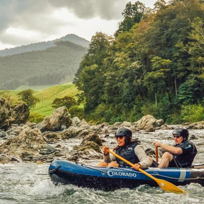 Couple kayaking rapids