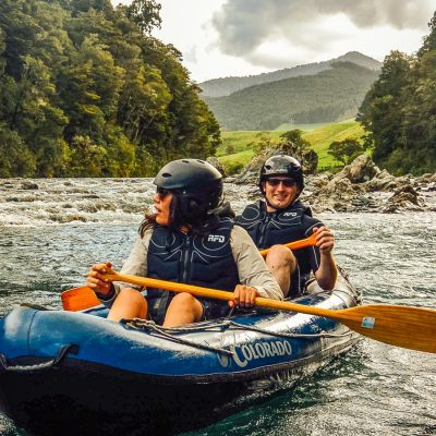 Couple kayaking a river in New Zealand