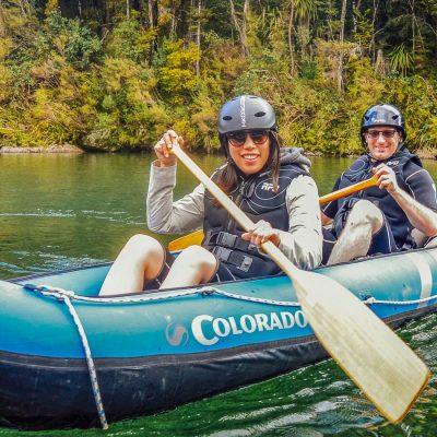 Friends kayaking in NZ