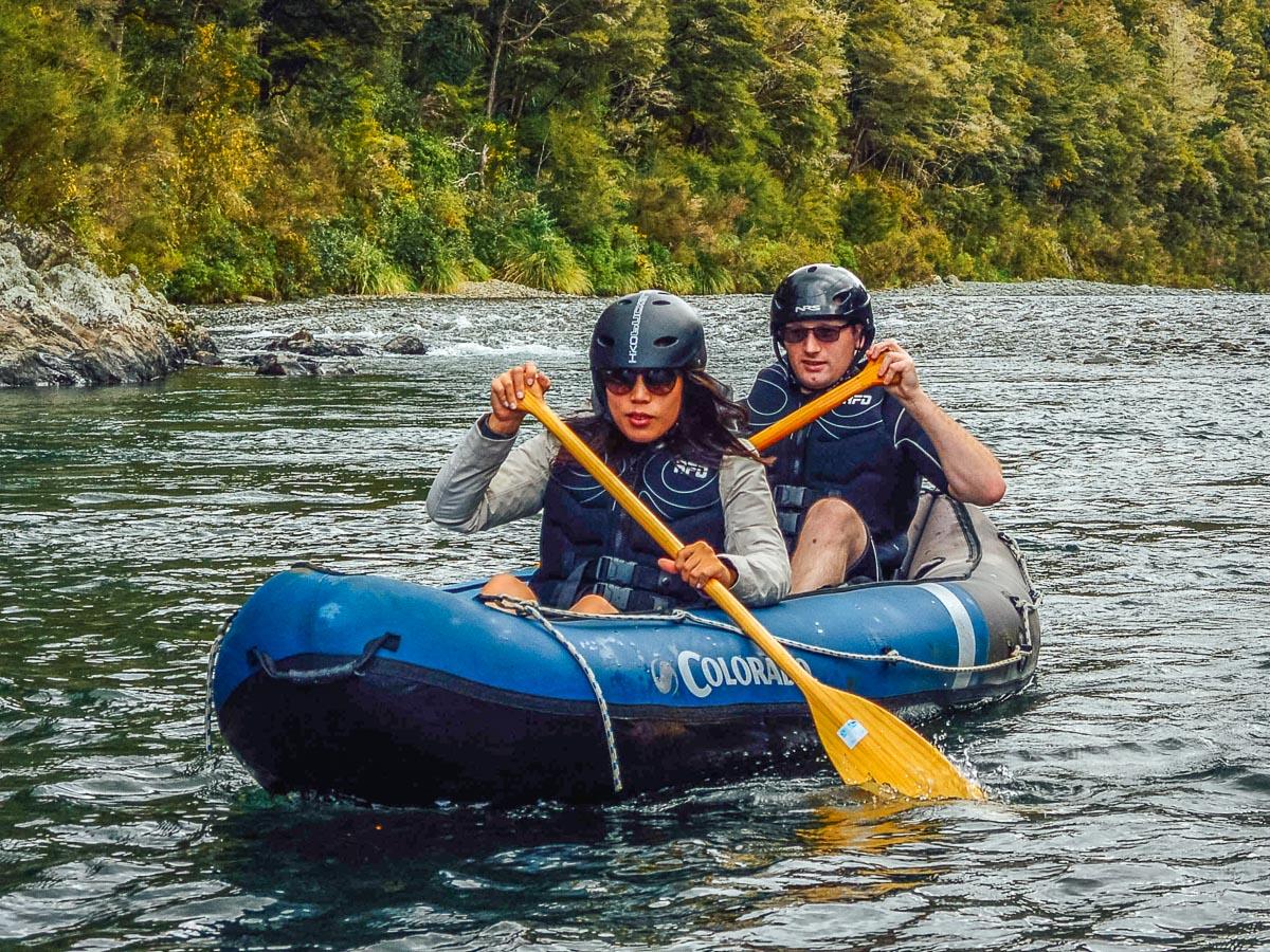 Friends kayaking a river in NZ