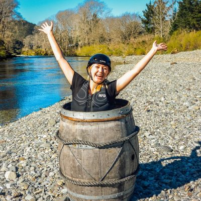 Happy girl in a barrel at the Pelorus river