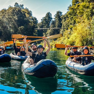 Happy group kayaking in New Zealand