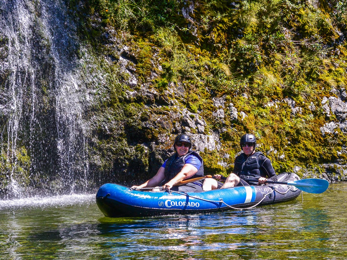 Couple kayaking the Pelorus river, NZ