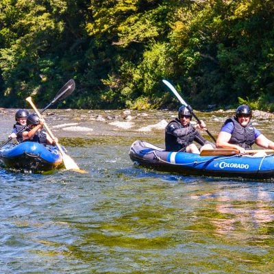 Family kayaking at the Pelorus river, Marlborough
