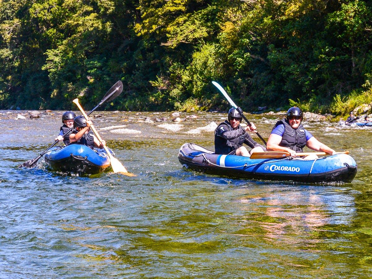 Family kayaking at the Pelorus river, Marlborough
