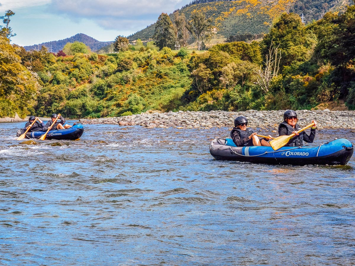 Friends kayaking in New Zealand