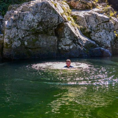 Kid bathing at the Pelorus river