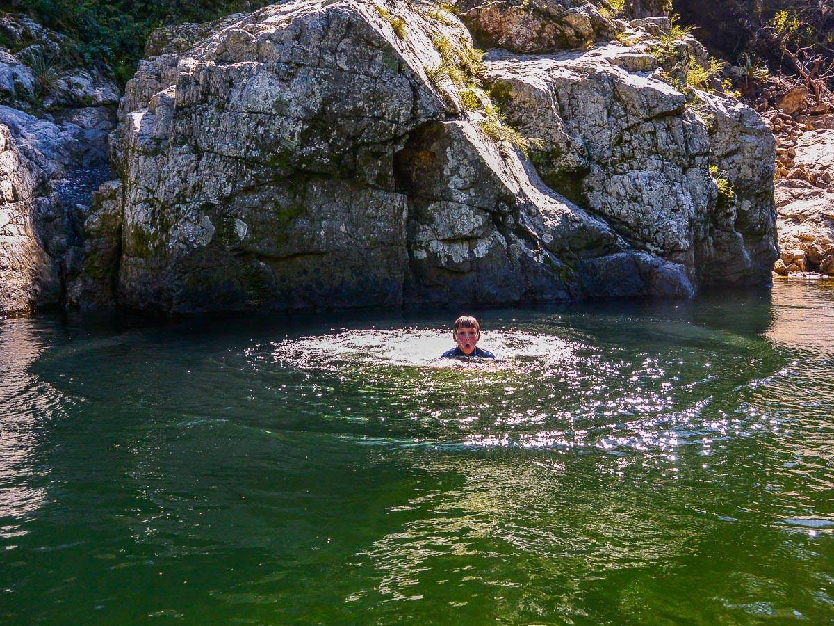 Kid bathing at the Pelorus river